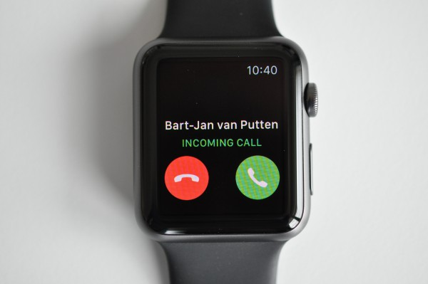 The Apple Watch shows who is calling. The user can then answer the call directly from the watch or get her iPhone out.
