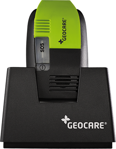 The GeoCare mPERS in a charging cradle.